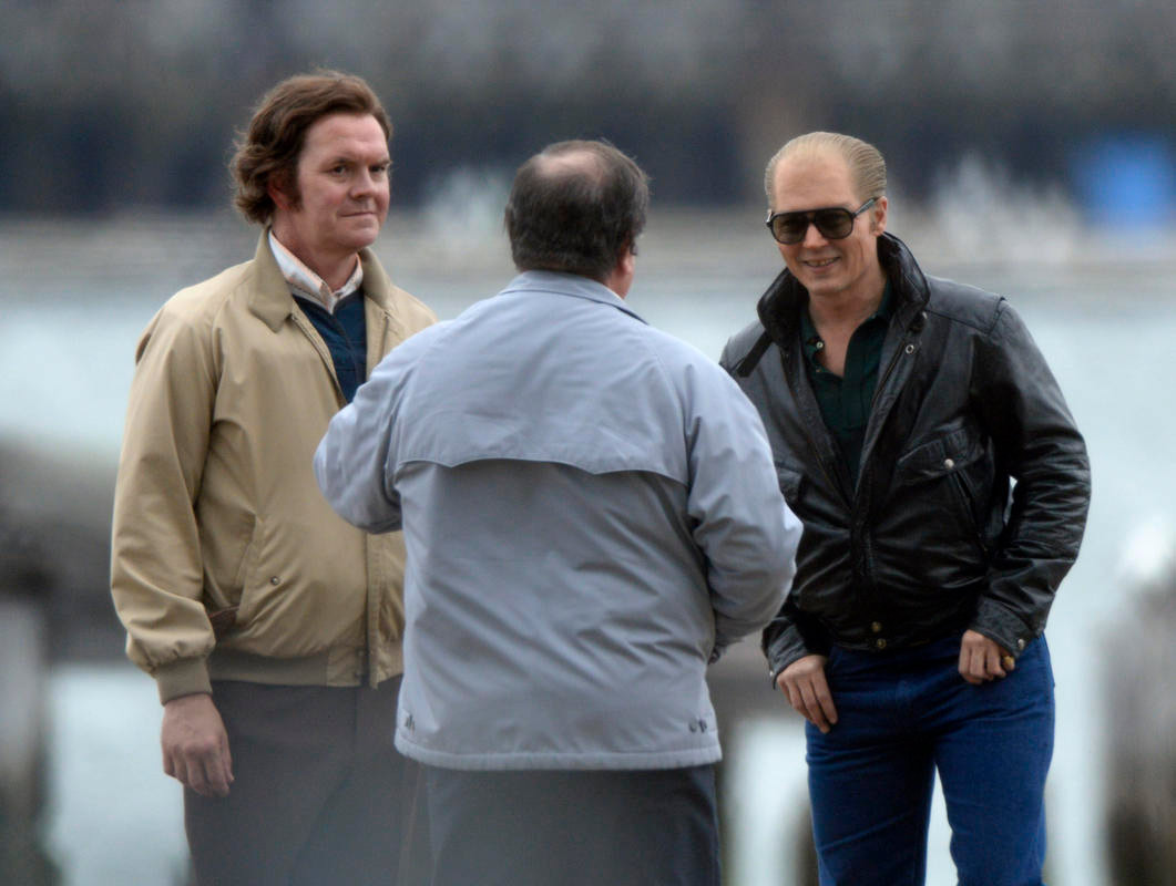 (Boston, MA, 05/27/14) Johnny Depp, right, smiles between takes during filming of the movie Black Mass in East Boston on Tuesday, May 27, 2014. Other actors are not identified. Staff photo by Christopher Evans.